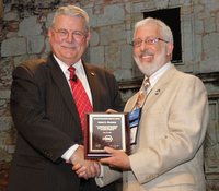 Ron Jarnagin (left), president of ASHRAE, congratulates Jim Newman on receiving the Distinguished Service Award at the ASHRAE Annual Conference.