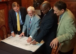 Bud Liebler, Jim Newman, Tupac Hunter and Andy Levin look at PACE energy efficiency upgrade plans for The Whitney